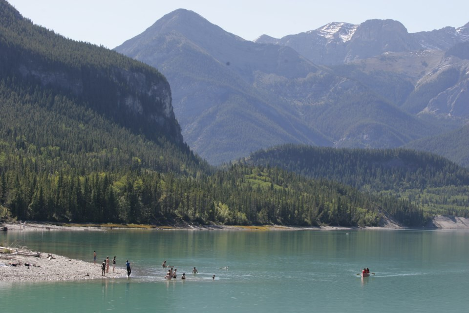 Sun-seekers flock to Barrier Lake in Kananaskis Country to enjoy one of the final days of beach weather for 2014.  RMO FILE PHOTO