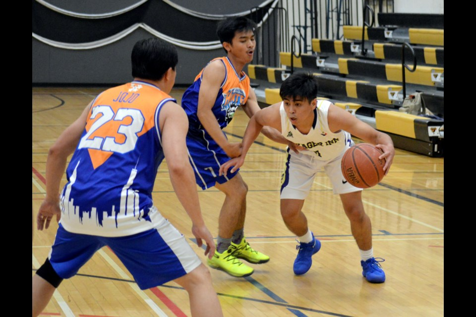 Voyager Inn's John Bunao dropped a game-high 29 points in the 75-71 victory over Hunter on Saturday (Aug. 3) at Banff Community High School gymnasium. Jordan Small RMO Photo