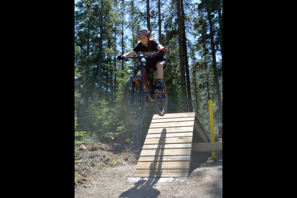 Carla Bown catches air on the three-foot drop and roll at the newly opened Quarry Lake Park drop zone in Canmore. Near Peaks Drive, the drop zone has a three-foot drop and roll, two-foot drop and one-foot drop for riders looking for a new challenge and progress skills. JORDAN SMALL RMO PHOTO