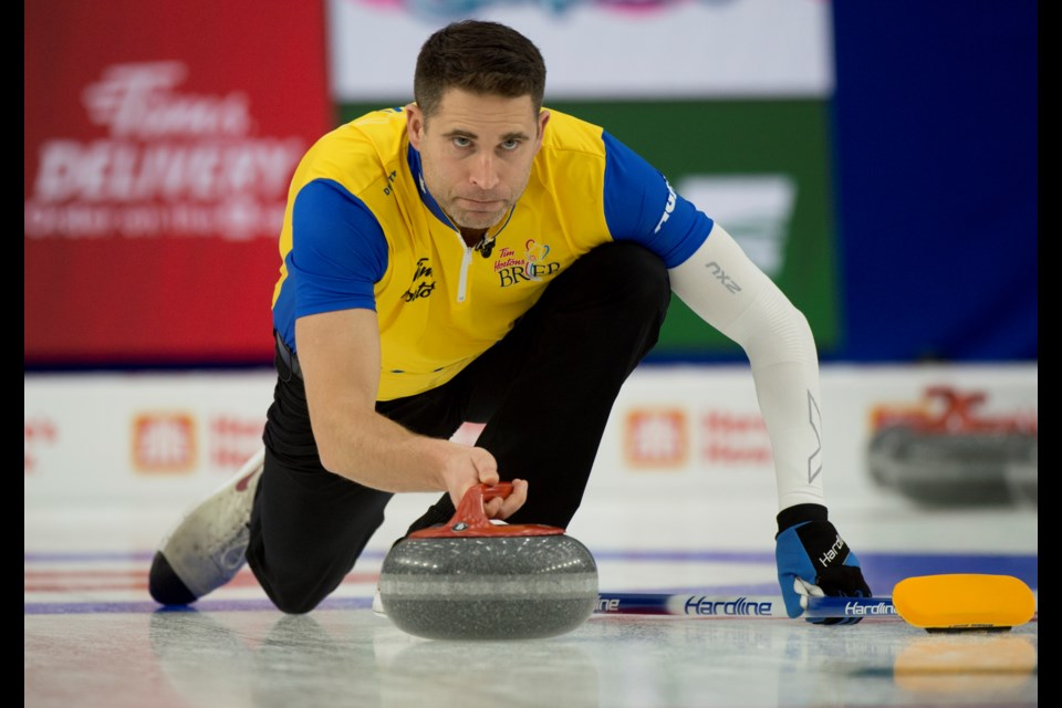Canmore's John Morris throws a stone while playing inside the Calgary bubble. MICHAEL BURNS CURLING CANADA