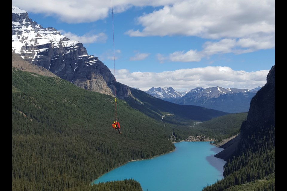 A Parks Canada public safety specialist is flown into 3/4 Couloir near Moraine Lake Saturday (July 18). PAUL CLARKE PHOTO