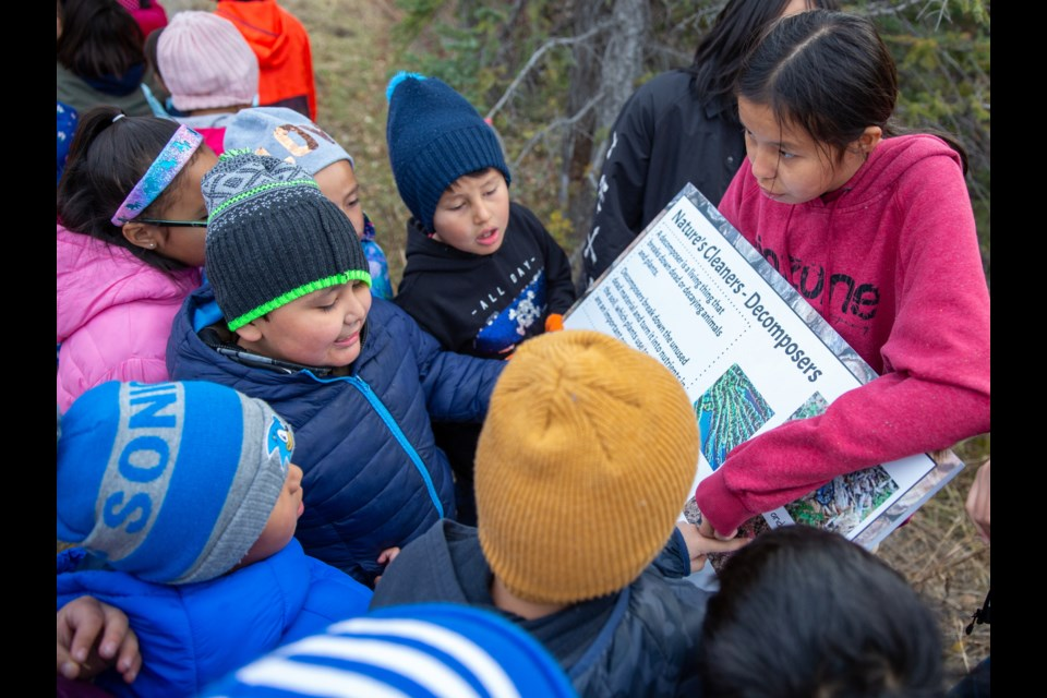 Grade 8 student, Shikoda Beaver explains one of the new interpretive signs, designed by Exshaw students, along the South Exshaw Trail in Exshaw on Tuesday (Oct. 22). EVAN BUHLER RMO PHOTO