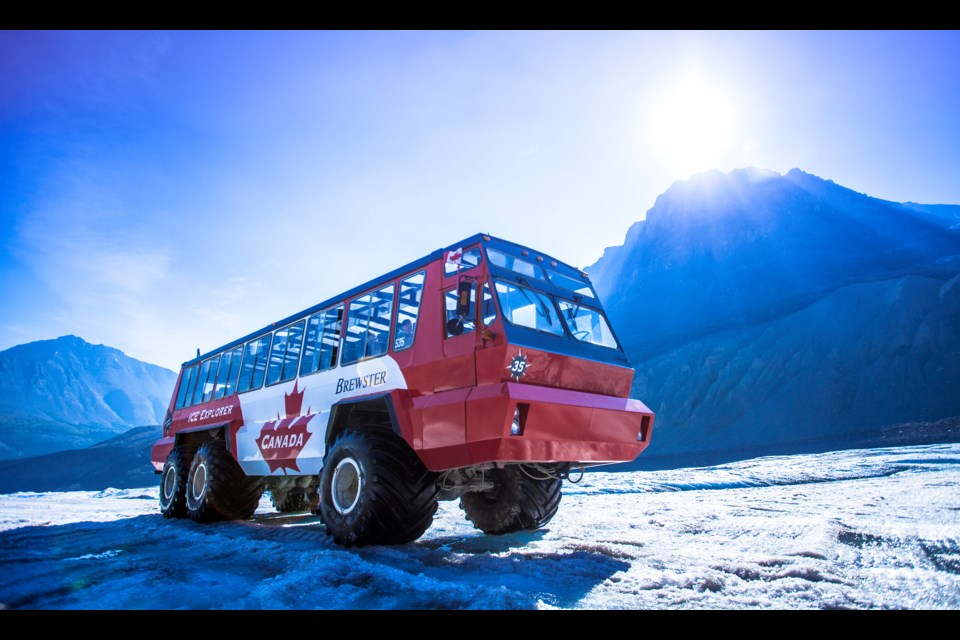 One of the specially designed Ice Explorer tour buses at the Columbia Icefield Adventure. On Saturday (July 18), one of the all-terrain vehicles rolled over en-route to the Athabasca Glacier injuring two dozen passengers and killing three. The investigation remains ongoing. PURSUIT PHOTO