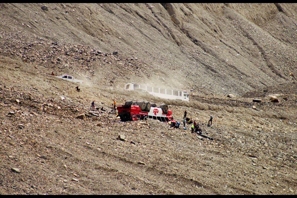 An Ice Explorer bus used to transport visitors to the Columbia Icefield is seen overturned Saturday (July 18). RCMP report multiple injuries from the incident, which occurred around 1 p.m. Beatrice Payette PHOTO
