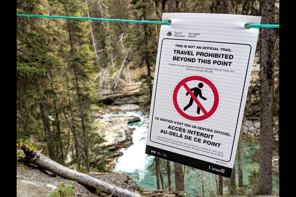 One of the 32 signs posted along the Johnston Canyon trail warning hikers not to go off the trail. 