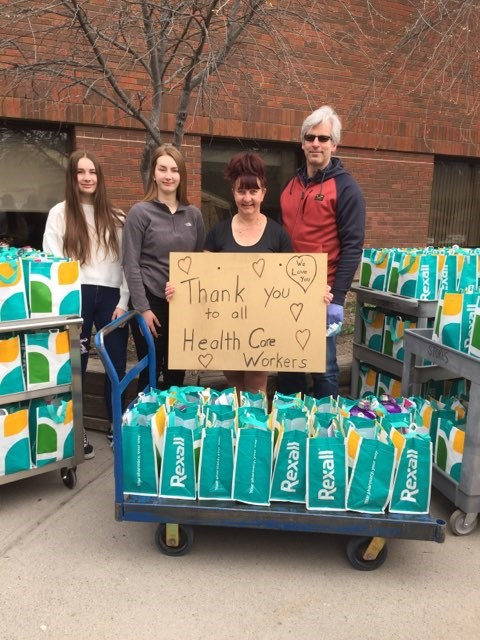 Deb Juravleff-Boucher with her husband Pierre Boucher, and their two daughters, Chloë and Sasha, delivered 125 care packages to the Canmore General Hospital earlier this month as a way to say thank you to frontline workers. PHOTO SUBMITTED