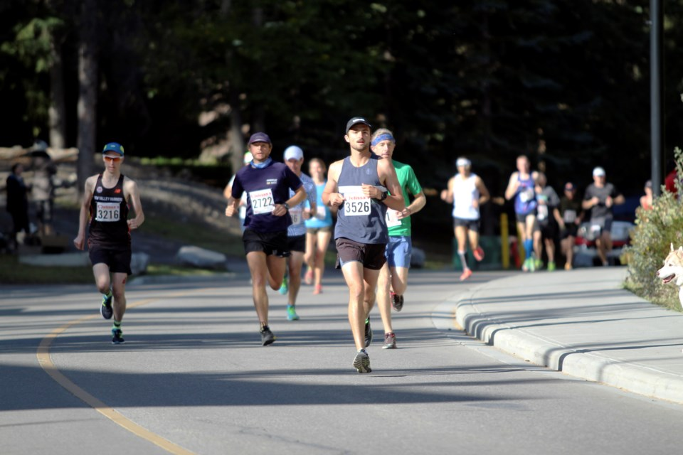 Banff's Jesse Kitteridge (#3526) finished third overall in the half marathon and Canmore's Theo Engman (#2722) was fourth at the 2021 Melissa's Road Race in Banff on Saturday (Sept. 25).  JORDAN SMALL RMO PHOTO