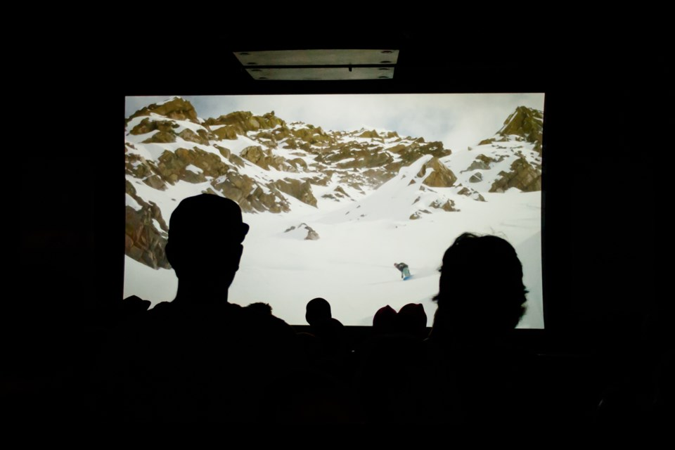 Guests watch a local film at the fifth annual Rockies Shred Fest 2019 at Wild Bill's Legendary Saloon in Banff on Thursday (Oct. 17). Celebrating the start of the ski and snowboard season the event features a selection of the best local ski and snowboard films in the Rockies paired with a winter trade show. CHELSEA KEMP RMO PHOTO