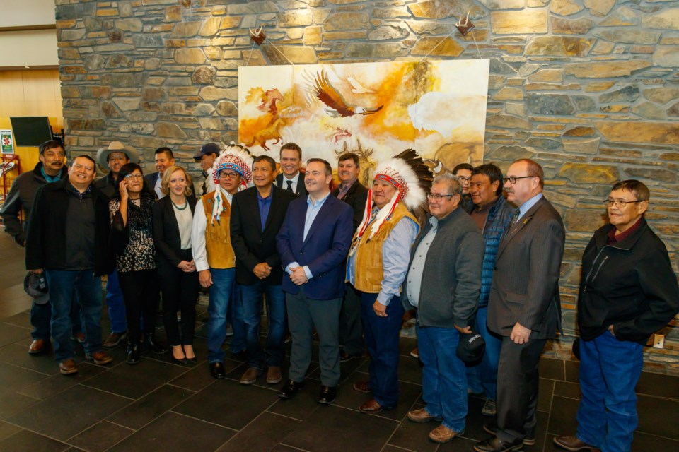 Premier Jason Kenney, Minister of Transportation Ric McIver, Minister of Indigenous Relations Rick Wilson, MLA for Banff-Kananaskis Miranda Rosin, MLA for Airdrie-Cochrane Peter Guthri, and Chiniki Chief Aaron Young, Wesley Chief Clifford Poucette and Bearspaw Chief Darcy Dixon gather with Stoney Nakoda First Nation residents during the announcement of funding to widen the 1A Highway on Tuesday (Nov. 12). CHELSEA KEMP RMO PHOTO