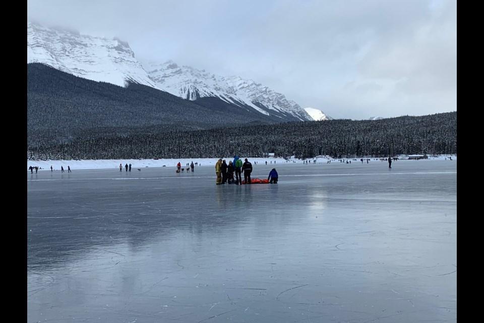 Paramedics respond to an injured skater on Lake Minnewanka Tuesday (Dec. 31). ELIZABETH HALL-FINDLAY PHOTO