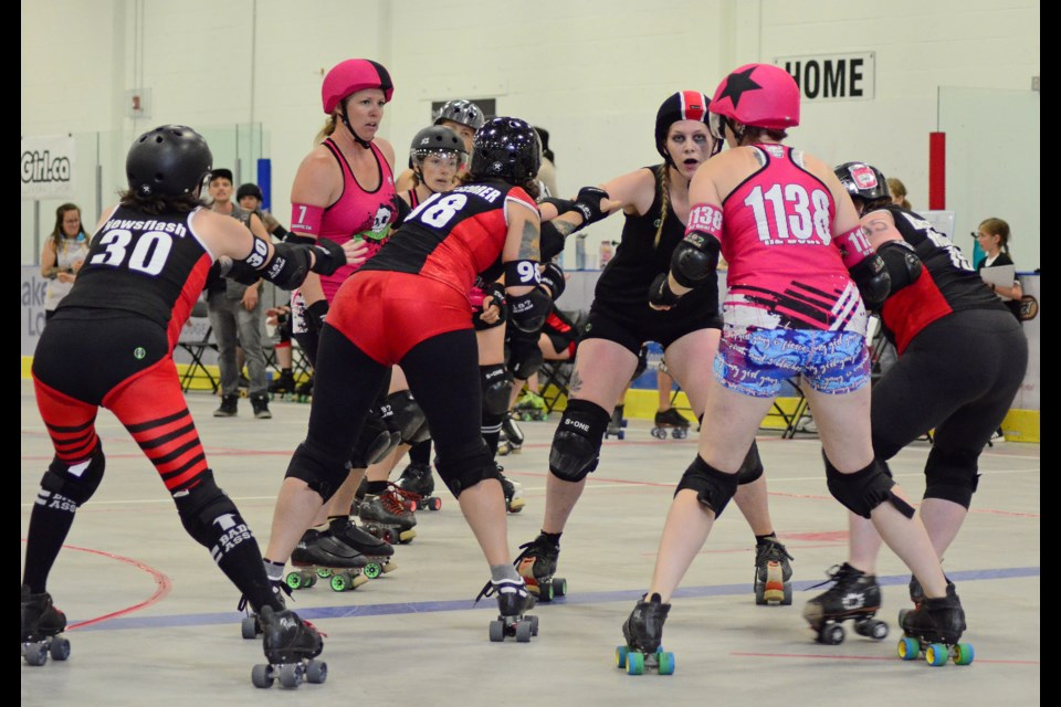 The Lady Macs (black and red) faced off against the Rocky View Rollers (pink) on Saturday, July 27, in the first competition Roller Derby bout the Bow Valley has seen since 2016.