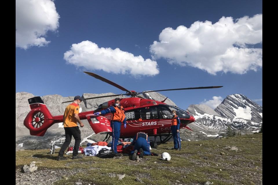 STARS air ambulance crew members assist an injured hiker in the Burstall Pass area. KANANASKIS PUBLIC SAFETY PHOTO