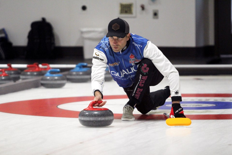 Canmore's John Morris and partner Rachel Homan are crowned back-to-back Qualico Mixed Doubles Classic champs in Banff on Sunday (Oct. 3). Morris and Homan defeated Jocelyn Peterman and Brett Gallant 6-5 in the final. JORDAN SMALL RMO PHOTO