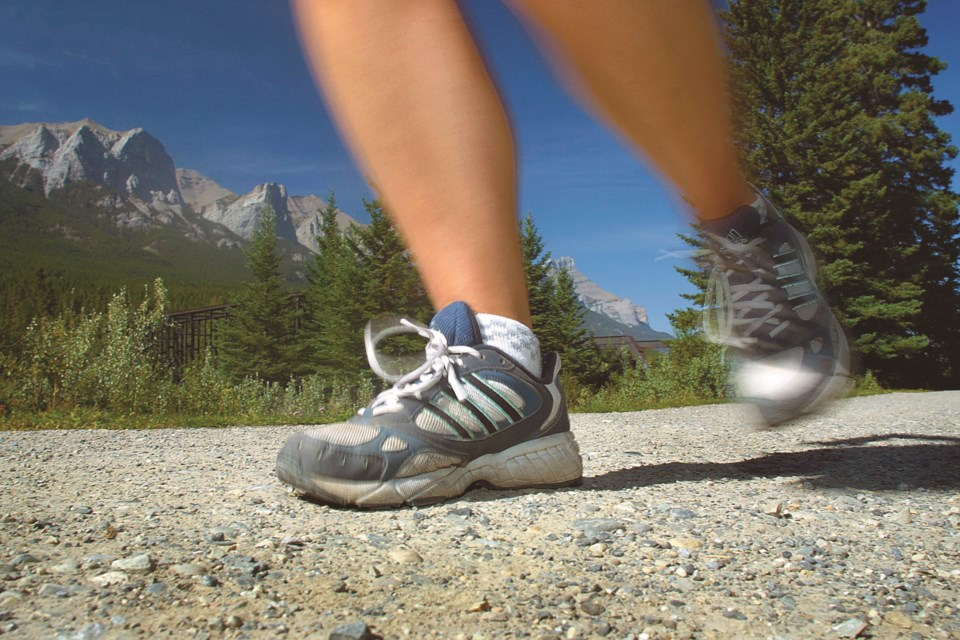 A runner hits the path in Canmore. RMO FILE PHOTO