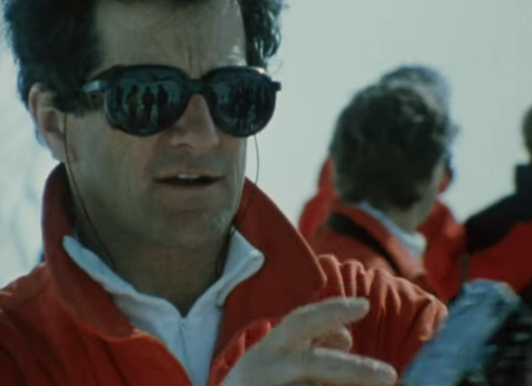 A screenshot of Mike Wiegele from the 1984 film Ski Country by Warren Miller.
