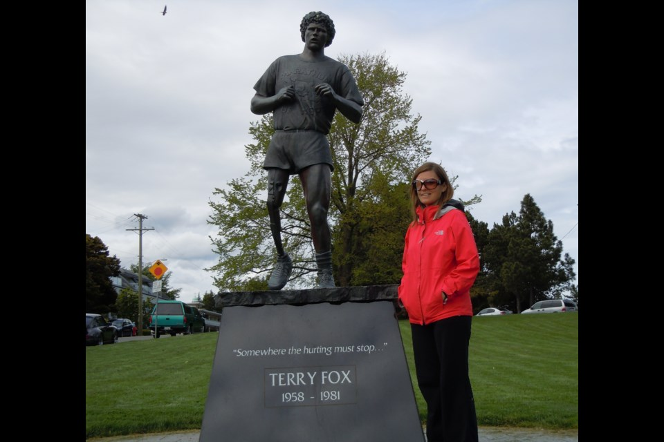 Michelle Fuller stands beside a Terry Fox statue in Victoria, B.C. SUBMITTED PHOTO