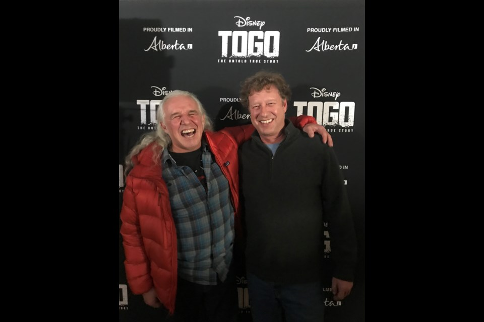 Yamnuska Mountain Adventures ACMG mountain guides Barry Blanchard, left and Dave Stark, celebrate at the Togo premier in Cochrane. SUBMITTED PHOTO