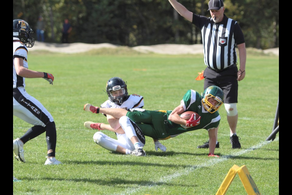 Kai Perron gets taken down near the sidelines against the Drumheller Titans on Saturday (Sept. 25) at Millennium Field in Canmore. JORDAN SMALL RMO PHOTO