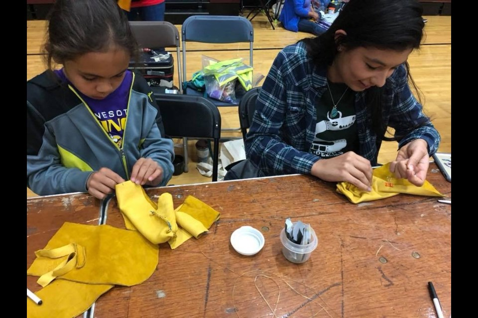 Youth participate in a moccasin workshop. Submitted Photo