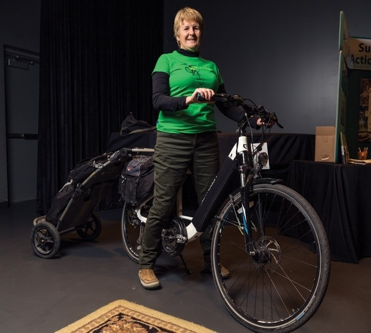 Mandy Johnson of Community Cruisers sits on her pedal assist electric bike in 2017. The e-bikes, which range from $2,000 to $5,000, can provide 100km of powered range and can