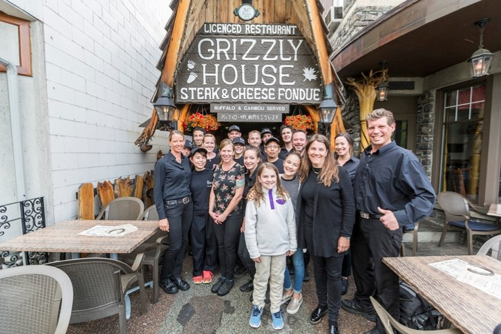 The staff of iconic food landmark the Grizzly House stand outside the Banff Avenue restaurant.