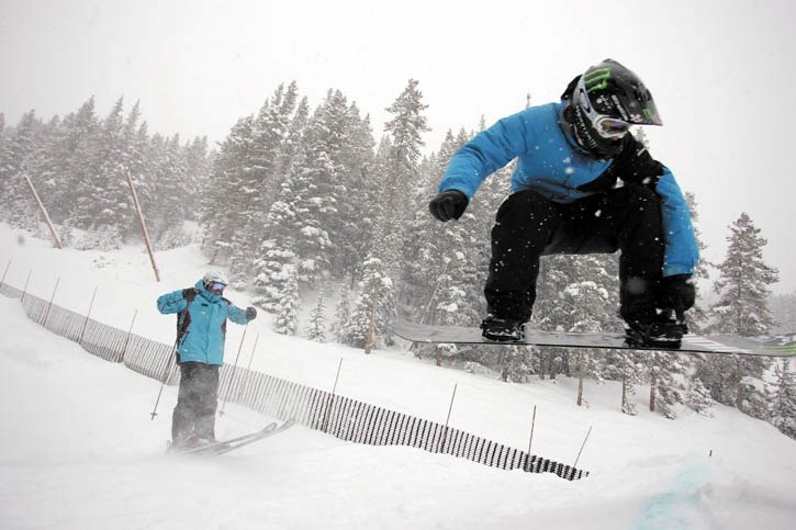 Ski and snocross track architect Johnny Balfour (right) and Evolve Ski and Snowboard club president Jim Sidorchuk (left) catch air off a step-up jump on the new ski and
