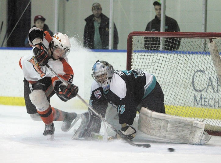 Eagles goalie Steve Papciak makes one of ten consecutive shootout saves to guarantee the win over Drumheller at the Canmore Rec Centre Saturday night (Jan. 15).