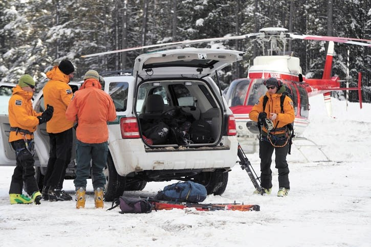 Parks Canada public safety staff prepare to search the debris field at the Norquay ski hill after an in-bounds avalanche occured Friday afternoon (March 11).