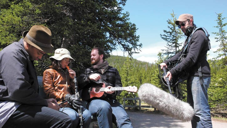 Musicians (L) Rollie Pemberton, Laura Barrett and Mark Hamilton record the soundtrack for the Waterton Lakes documentary.