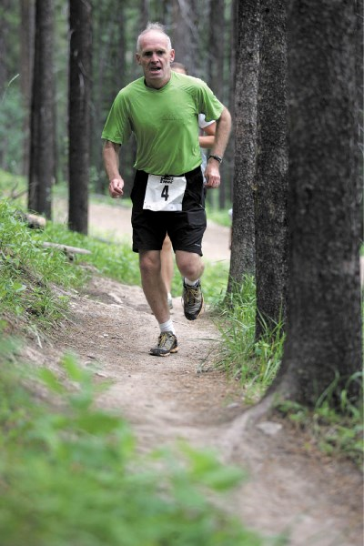Tony Lambert from Edmonton races to victory during the four-kilometre distance race at Saturday's (July 9) Canmore Challenge Trail running event at the Canmore Nordic Centre.