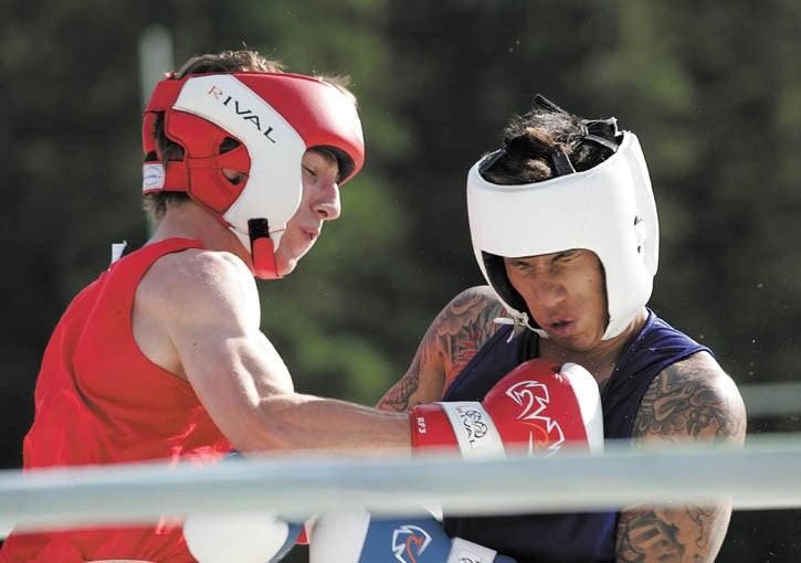 Local fighter Neal Greaney lands solid leather on Jeremy Divina during their K.O. For Cancer bout in Canmore Saturday (Aug. 6).