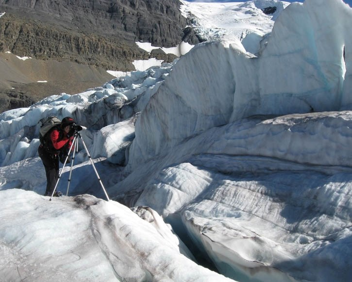 Artist Jan Kabatoff trains her lens on the fascinating features of an icefall on the Athabasca Glacier to capture images for her ongoing exhibit on glaciers.