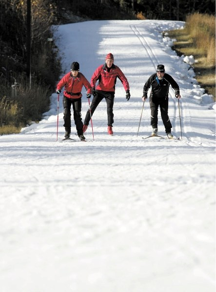 Judy Buchanan-Mappin, Dave Rees and Mike Mappin enjoy getting back on skis as they take to the Canmore Nordic Centre's Frozen Thunder ski loop Saturday (Oct. 15). The trail