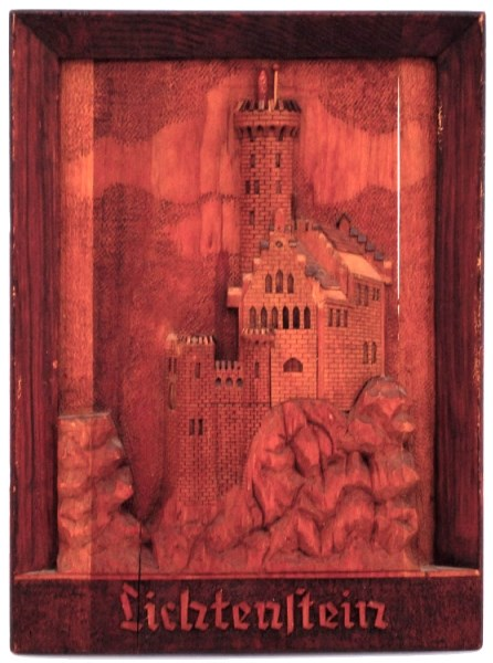 A wooden wallhanging carved at the Ozada prisoner of war camp by a German PoW during the Second World War.