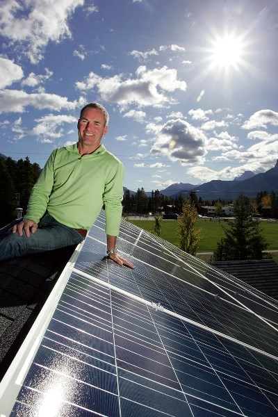 Canmore's Joey O'Brien shows off the 40-panel solar energy system on the roof of his family home.