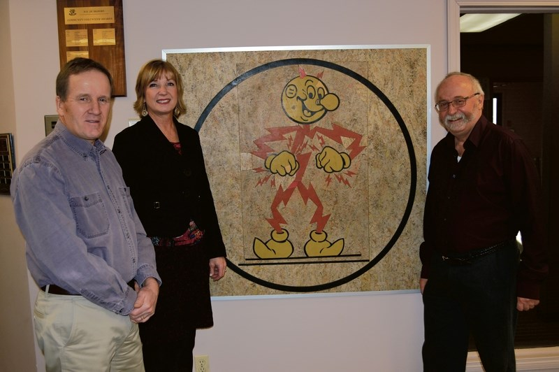 The restored Reddy Kilowatt logo displayed in the MD of Bighorn office in Exshaw. Martin Buckley, Bighorn chief adminstrative officer, left, Tavia Tilson, Armstrong World