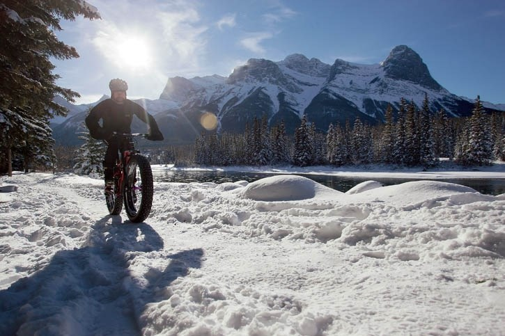 Ryan Draper rides his fat bike along the Bow River in Canmore.