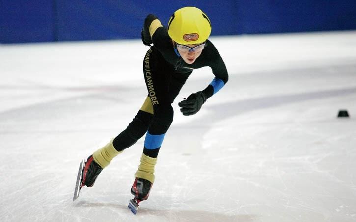 Sebastien Parent streaks around the ice during speedskating action at the Canmore Rec Centre Saturday (Dec. 12).