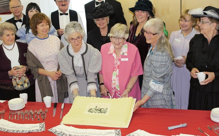 Louise Mattson, 92, cuts the cake celebrating the 125th anniversary of the Ralph Connor Memorial United Church.