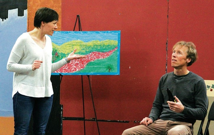 Jeremy White, right, as Miles, ponders Heidi Books' (Lacy) explanation of her art during a rehearsal of My Narrator at the Canmore Miners' Union Hall, Sunday (March 27).