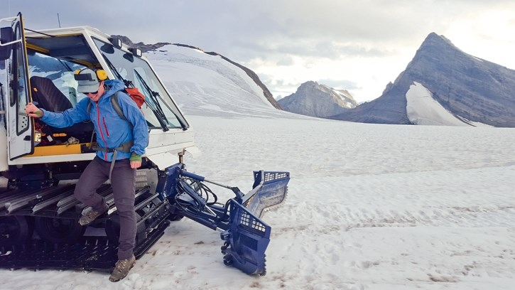 Darren Farley steps onto the Haig Glacier to begin his nightly grooming duties.
