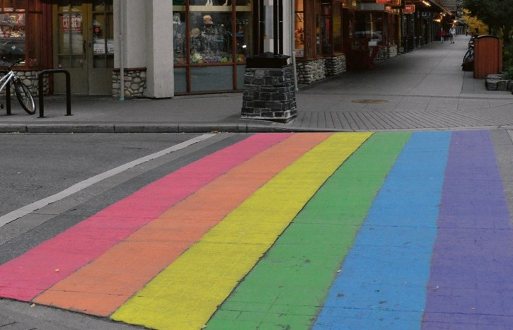 A street crossing painted in honour of Banff Pride at Wild Bill's Saloon.