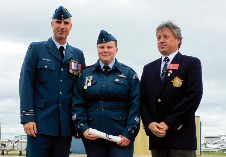 Presenting Power Pilots wings to Warrant Officer Second Class Catherine Van Dorsten was Major Phil Shilling, CD Flight Commander at CFFTS Moose Jaw and Brian Lewis, Assistant
