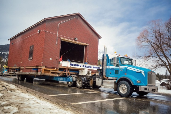 The historic icebox building is moved across the rail yard at the Banff Railway Station on Tuesday (March 14).