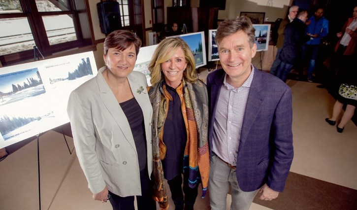 Banff's mayor Karen Sorensen, left, along with Jan and Adam Waterous from Liricon Capital, stand in front of revitalization images at the Banff Train Station on Tuesday