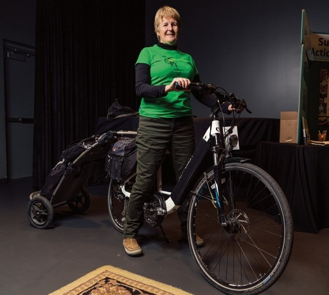 Mandy Johnson sits on her pedal assist electric bike at artsPlace in Canmore on Sunday (Oct. 29). The Biosphere Institute put on an afternoon of learning about e-bikes,
