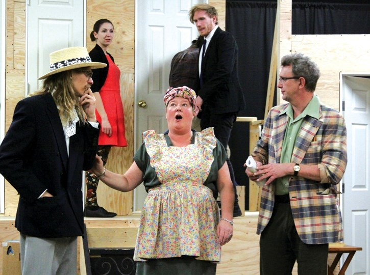 Part of the cast of Noises Off rehearses at the Canmore Miners' Union Hall, Thursday (Nov. 2). At rear are Candise McMullin (Brooke) and Marcus Williams (Garry) with John