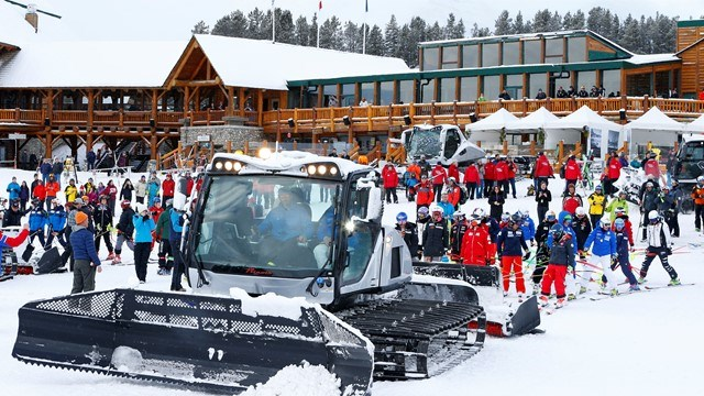 A Prinoth snow-groomer prepares to tow racers and officials with the 2017 Audi FIS Ski World Cup to the start of the race course at Lake Louise ski hill after a power outage