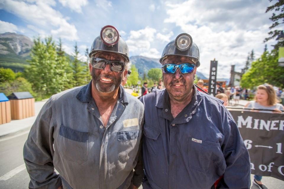 Larry Anderson, left, and Rob Bushulak head up the annual Miners' Day Parade in Canmore on Saturday (July 13). This year marks the 40th anniversary of Black Friday, the day the mines closed. ARYN TOOMBS RMO PHOTO