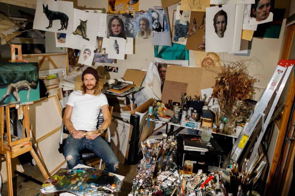 Artist Michael Corner sits in his studio in Banff on Monday (Nov. 4). CHELSEA KEMP RMO PHOTO